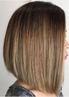 blunt cut asymmetrical bob on bronde hair color