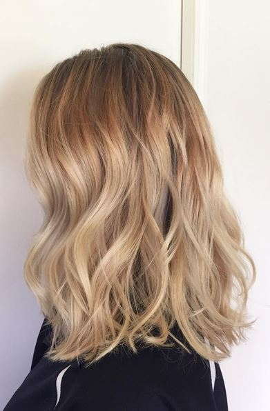 Bleach blonde hair with caramel highlights